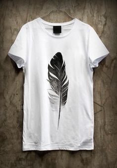Feather t-shirt...hmm..I think this could be a DIY...stamp it...a real feather?