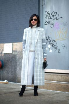 Nicole Warne Wears The Yigal Azrouël Windowpane Plaid Coat, Engineered Knit Turtleneck Tank, And Ivory Cashmere Trousers