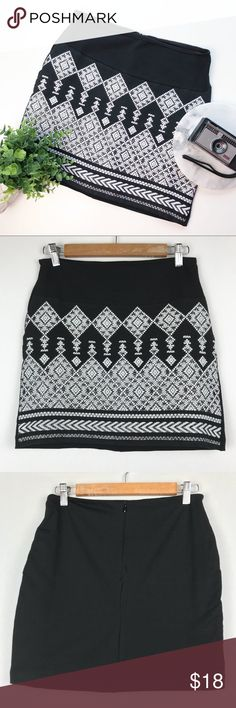 """H&M Black Mini Skirt Aztec Embroidered Metallic H & M black mini skirt with white and metallic embroidered aztec type design. Really darling! Fully lined. Size Small Waist, side to side: 14"""" Length, top to bottom: 15.5"""" Inventory:N27 H&M Skirts Mini"""