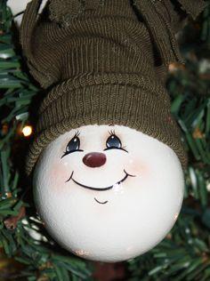 Hand Painted Snowman Light Bulb Ornament. $11.00, via Etsy.