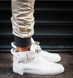 The latest instalment from Jon Buscemi is the full grain Italian leather high-top sneakers, with gold detail on the ankle strap. Me Too Shoes, Men's Shoes, Nike Shoes, Shoes Men, Roshe Shoes, Nike Roshe, Shoes Style, Buscemi Sneakers, Fashion Shoes