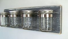 Enjoy stylish bathroom storage with our rustic Mason jar toothbrush holder. Built with new wood and 4 new half-pint size Mason jars the size of the board is approximately wide and tall. Bathroom Caddy, Mason Jar Bathroom, Pallet Bathroom, Small Bathroom, Bathrooms, Mason Jar Hanger, Ball Mason Jars, Shabby Chic Decor, Rustic Decor