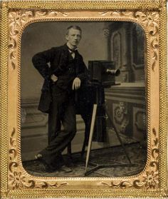 Tintype portrait of a gentleman with a camera #1875 #1870s