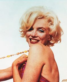 """MARILYN MUSEUM  This photograph released by the Brooklyn Museum of Art, titled """"Marilyn Monroe: Pulling Beads,"""" is part of show opening at the museum Friday, Nov. 12, 2004. The 1962 pink tinted photograph by Bert Stern is one of more than 200 Monroe pictures from 39 photographers - including luminaries such as Richard Avedon, Gordon Parks, Robert Frank and Andy Warhol - in the museum's new exhibit, """"I Want to Be Loved by You: Photographs of Marilyn Monroe."""" (AP Photo/Brooklyn Museum of Art…"""