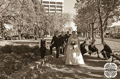 I love the sepia tone on this fun picture of the entire wedding party.