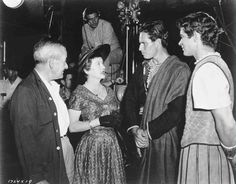 "MGM's ""Ben-Hur"" (1959) behind-the-scenes shot of director William Wyler, visitor Bette Davis talking with star Charlton Heston and co-star Stephen Boyd"