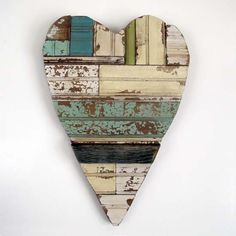 "CuriousSofa Scrap Wood Heart BACK IN STOCK! Add a loving reminder to your home with this all wooden heart. Made from scraps of wood in painted colors of ivory and green. Now is a perfect time of year to add this to your porch or potting shed. Back clips for hanging. 14"" wide x 20"" high $47.50"