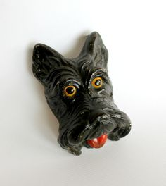 As a perfect touch for a small area, this chalkware scottie dog plaque will…