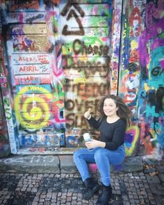 """""""Prague is a beautiful city with a painful history of war. John Lennon Wall is where people from all around the world leave their belief in peace and humanity through street art. Grab some graffiti paint, and leave your permanent mark here just like I did! Enjoy your legally permitted artistic vandalism here!""""  NessieOutOfWater.com"""