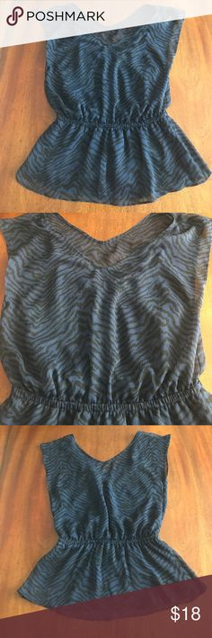 Express Black and navy animal print blouse A black and blue animal print blouse from Express. Elastic at the waist. Lined by a slip underneath. Perfect print for a night out. Worn once. Express Tops Blouses