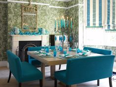 Turquoise benches around the dinning room table . . . <3 IT!