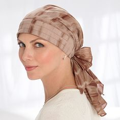 Pre-Tied Chemo Scarves, Cotton Head Scarves - comes in several colors including denim. I was thinking that this might look cute peeking out from a sun hat.