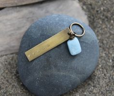 This key chain is inspired by my Five Deep Breaths practice, which invites you to pause and take five deep breaths with intention. As you breathe, relax your shoulders, notice how your breath moves in your body, try to let go of anything pulling on you, feel the space you create inside you, and let your mind rest in this space.