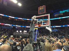 @UConnWBB coach Geno Auriemma climbs to the top of the @wernerladderco ladder to cut down the net  #champs #wbca15