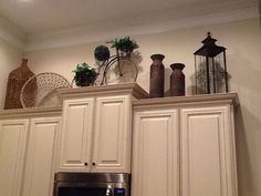 crown moulding and knick knacks on the top of kitchen cabinets!