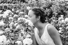 Happy young bride and the roses by LaurentLothareDambreville