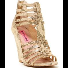 "Betsey Johnson wedge sandals Amazing gold ""snake"" print. 4.25"" wedge .25"" platform. Back zipper. New with tags. No trades, no paypal, lowest price listed!! Great buy before spring and summer! Model shows same sandal in black. Mine is the gold color shown. Betsey Johnson Shoes Sandals"