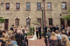 How picturesque is this courtyard wedding ceremony?  Riverside Receptions and Conference Center | Joy Lyn Photography