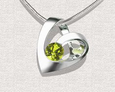 Argentium silver and peridot pendant designed by David Worcester for VerbenaPlace.Etsy.com