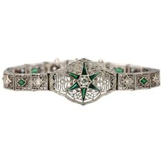 This Victorian bracelet features 9 round white diamonds weighing carats and 13 triangle green emeralds weighing carats.Beautiful details and articulated White GoldThe length of the bracelet is and the width is Antique Bracelets, Diamonds And Gold, Emerald Green, Turquoise Bracelet, White Gold, Victorian, Retro, Antiques, Women's Rings