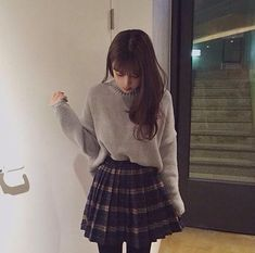 grayish beige oversized sweater - dark blue plaid a line skirt - black tights