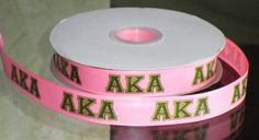 "This listing is for 2 continuous yards of 7/8 wide pink grosgrain/double faced satin ribbon (you choose, just memo which one you'd like when checking out) with ""AKA"" printed on it in green.  The pictu"