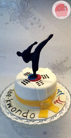 Taekwondo cake. I'm going to need this with a black belt for my girls.