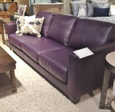 Leather sofa in eggplant.  Available in many styles, configurations. Both leather and fabrics to choose from!