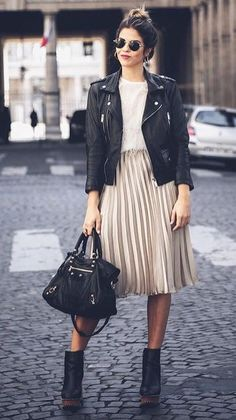 Black leather moto jacket over white tee and blush pleated skirt.