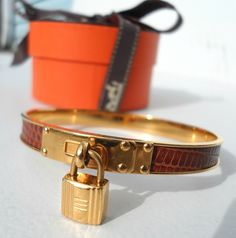 Hermes Kelly H Lock Cadena Bracelet Hermes Jewelry, Hermes Bracelet, Cuff Bracelets, Jewelery, Bangles, Leather Jewelry, Jewelry Accessories, Fashion Accessories, Jewelry Design