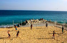 Sandy beach on Nice public beach plage, French Riviera, France