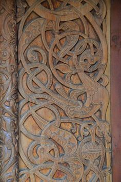 Door Carving, intricate wood carving typical of the Medieval Nordic tradition. Chapel in the Hills, Rapid City, South Dakota. a near exact replica of the Borgund Stave Church in Norway. Wood Carving Faces, Wood Carving Designs, Wood Carving Patterns, Wood Carving Art, Wood Art, Wood Patterns, Vikings, Whittling Wood, Viking Art