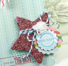 Maya Road spool sentiments on chipboard scallop on glitter heart with twine & flower