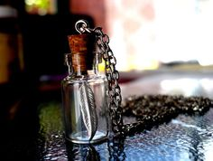 Miniature Feather Glass Vial Necklace.  Available from: www.inspirations.mysupadupa.com