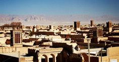 Rooftops sporting badgirs (wind towers common in the region to combat the brutal summer heat) in the delightful old city of Yazd, as viewed from the roof terrace of the Amir Chaghmagh mosque.  Few Iranians or visitors dispute that Yazd is home to the friendliest people in Iran, and many stay here much longer than they expected.