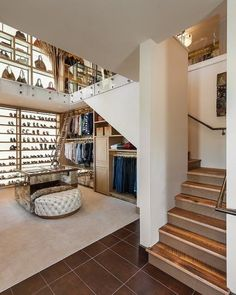 You know a closet is amazing when it's two floors and there is room for an ottoman, an open railing, a ladder, and stairs. #Decor #DreamCloset