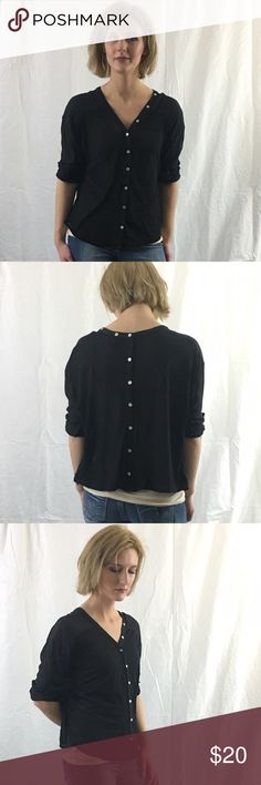 Black Dolman Cardigan Top This blouse is a must have staple piece for any outfit. Pair with jeans or shorts, or work pants. This top is slightly sheer so be sure to pair with your favorite black cami or bralette. There are functioning buttons in the front of the top for an open or closed look. There is also a button detailing in the back of the top and are not functional. The Sleeves can be worn rolled up or left down. Chic Couture Tops Blouses