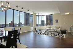 Spectacular, loft-like duplex penthouse with balcony and skyline views in the heart of midtown and Murray Hill. Best per-square foot condo deal in the city! Upper floor: 1150sf living/entertainment area with chef's kitchen,  bar, and full bath. Lower floor: 1150sf bedroom suite with two full bathrooms, Jacuzzi, marble shower, and 200sf dressing area. A skylight floods the entry and staircase between the floors with light. Attractive elevator landing, wraparound windows, electronic window…