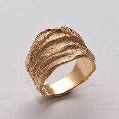 I don't care if this is a guy's wedding ring. The texture is amazing - I'd totally wear it!