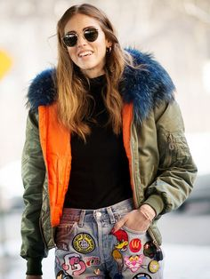 Chiara Ferragni wears a fur-trimmed parka with a black top and cool embellished denim.