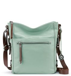 Crafted from supple brushed leather, the Sanibel Crossbody in Mint adds a refreshing pop of pastel color to any look. Go hands free with this lightweight shape, with interior organization to hold your staples.