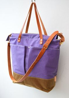 A purple waxed-canvas diaper bag is playground-ready.