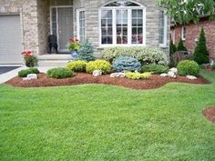 Bark mulch and low profile plants, tiered.
