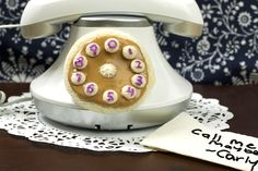 Call Me Maybe.  Rotary dial telephone phone with a white bread finger wheel, Smooth Operator peanut butter, and grape jelly numbers.