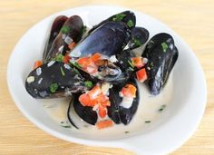 "Coconut Lime Mussels - Low Carb - Handful of simple ingredients, on the table in 30 minutes. ""The mussels swim in a creamy coconut broth spiked with shallot, garlic, ginger and lime juice. It can be sipped like soup or soaked up by cauliflower rice."""
