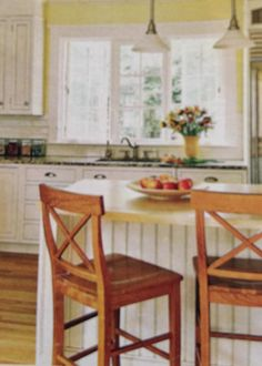 A yellow kitchen the new hot color for 2014 with White kitchen cabinets, beadboard and I love the triple window! White Kitchen Cabinets, Kitchen Redo, Leather Bar Stools, Farm House, Home Kitchens, Window, Yellow, Hot, Table