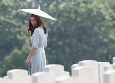 Pin for Later: The Royal Family's Travel Album Singapore The Duchess of Cambridge glanced at graves at a Singapore WWII memorial.