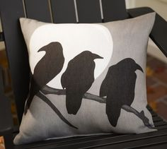 Crow & Moon Outdoor Pillow | Pottery Barn - you could totally do this yourself with black paint!