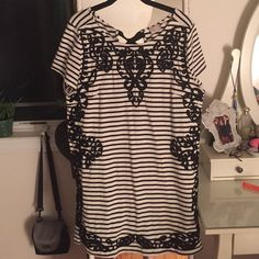 Anthropologie Striped Dress black and white stripped dress with black embroidery. Size XL. Perfect condition! 100% cotton so it is great for spring and summer!! Anthropologie Dresses Mini