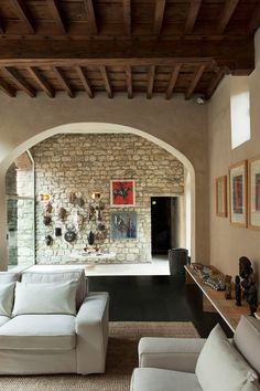 Architect+Bruno+Sacchi's+collection+of+African+masks+is+displayed+in+the+sitting+room.